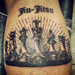 Brazilian jiu jitsu tattoo on calf chess figures