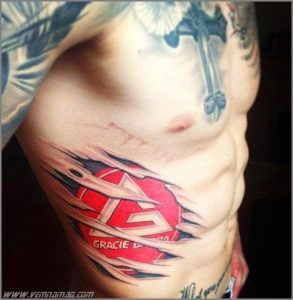 Brazilian jiu jitsu tattoo gracie barra logo on ribs