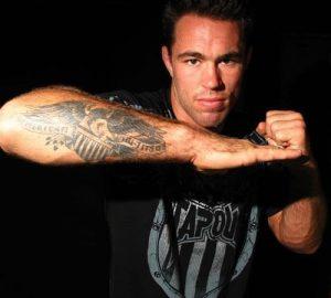 American jiu jitsu tattoo on forearm