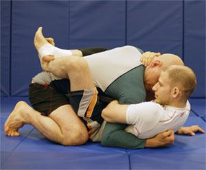 closed OH head grip - BJJ Grips & Grip Positions For Gi And No-Gi Jiu-Jitsu