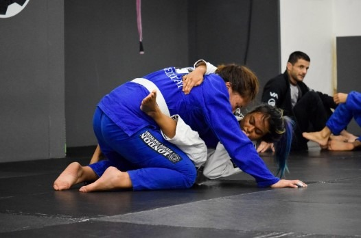 Woman in Closed Guard Trying a Sweep