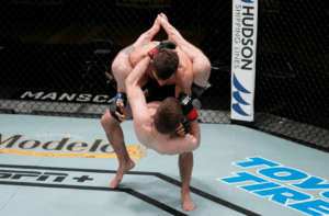 download 2020 12 20T112158.533 300x197 - Amazing Flying Triangle At UFC Vegas 17 by BJJ Black Belt Jimmy Flick